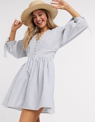 ASOS DESIGN button neck mini smock dress with tie sleeves in navy white stripe