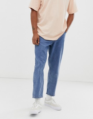 ASOS tapered jeans in 14 oz mid wash denim
