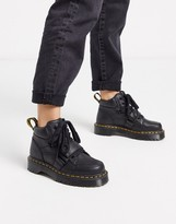 Dr. Martens Zuma with buckle strap flat ankle boots in black
