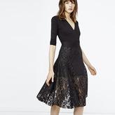 Maje Embroidered basket knit flared skirt