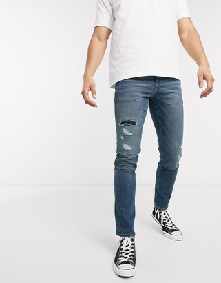 ASOS DESIGN 12.5oz slim jeans in vintage mid wash blue with rip and repair