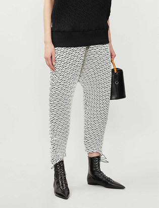 Issey Miyake Harem wide-leg high-rise woven trousers