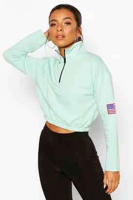 boohoo Petite Zip Up Flag Badge Crop Sweatshirt