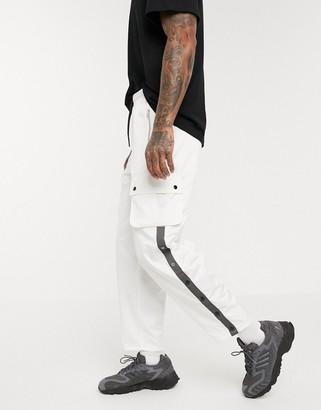 ASOS DESIGN wide leg cargo pants with elastic wasit in white nylon