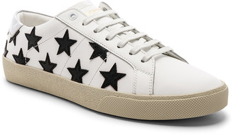 Saint Laurent Leather SL/06 Low-Top Star Sneakers in Optic White & Black & Silver | FWRD