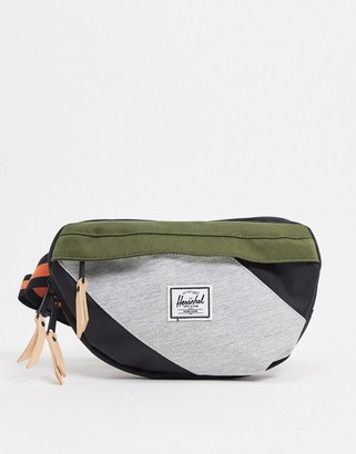 Herschel Nineteen fanny pack in block stripe pattern