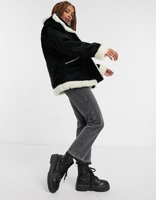 Monki Shea cord faux-shearling lined jacket in black