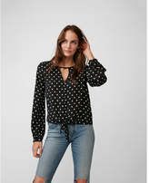 Express polka dot tie front cut-out blouse
