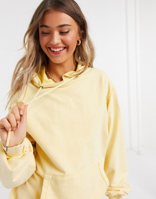 ASOS DESIGN oversized boyfriend hoodie in washed yellow