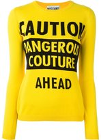 Moschino caution dangerous couture jumper