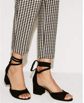 Express ankle tie low heeled sandals