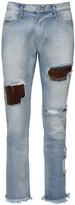 424 Light Wash Indigo Destroyed Denim Jeans