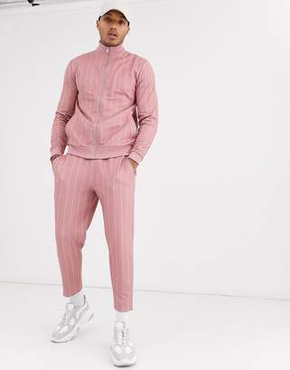 Asos Design DESIGN tracksuit with track jacket and tapered sweatpants in pinstripe-Pink
