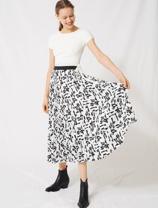 Maje Pleated skirt with an arty print