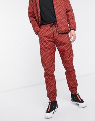Criminal Damage nylon tracksuit pant in red pattern