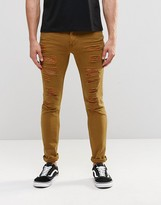 Asos Super Skinny Jeans With Extreme Rips In Brown