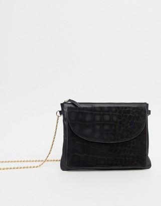Urban Code Urbancode real leather foldover cross body bag