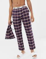 Asos Design ASOS DESIGN woven straight pyjama bottoms in deep colour brushed check in gift bag