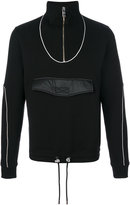 Versus piped track top