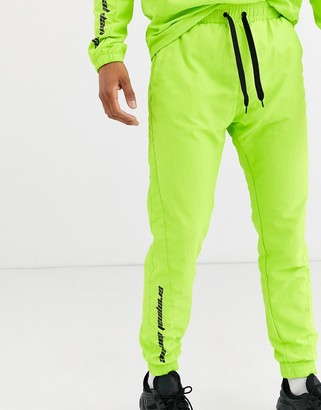 Criminal Damage co-ord nylon joggers in neon green with logo