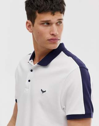 Threadbare polo shirt with cut and saw panels-White