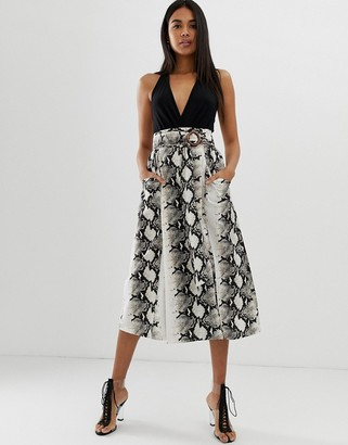 Asos DESIGN wrap midi skirt with wooden buckle and pockets in snake print