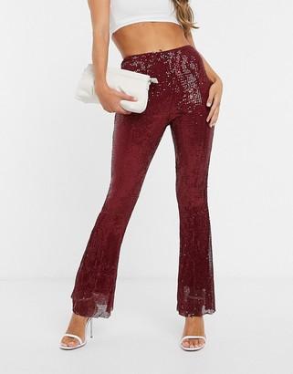 Club L London plisse sequin trousers in burgundy