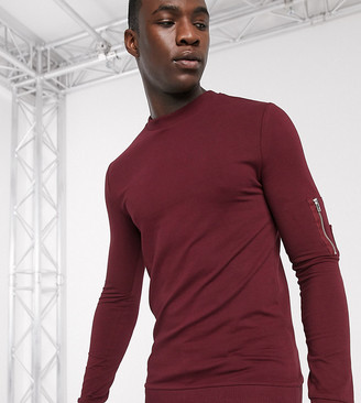 ASOS DESIGN Tall muscle sweatshirt in burgundy with MA1 pocket