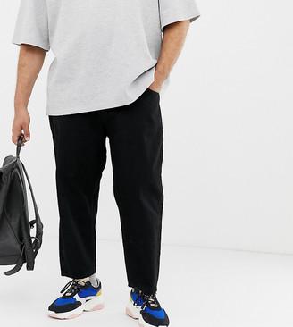 ASOS Plus tapered cropped jeans in 14 oz black denim