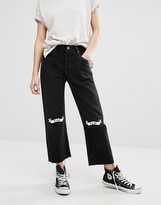 Reclaimed Vintage Ripped Knee Jeans With Love Hate