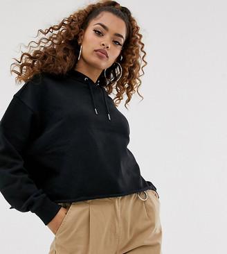 Asos DESIGN Petite boxy hoodie in black