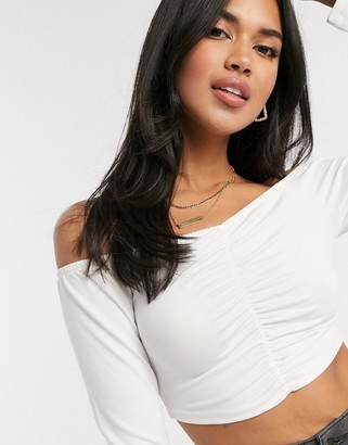 NA-KD off shoulder cropped top in white