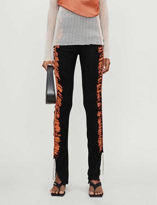 Leo Tie-dye pattern slim-leg high-rise stretch-knitted trousers