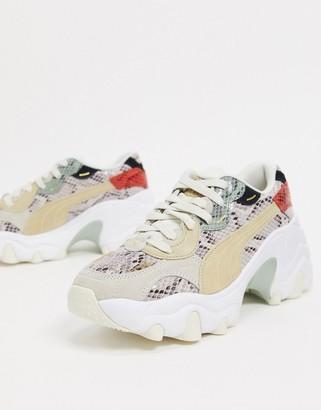 Puma Pulsar Wedge sneakers in animal print