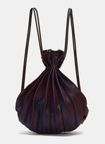 Issey Miyake Wave Pleated Drawstring Backpack in Blue, Red and Black