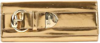 Gucci Gold Patent leather Clutch bags