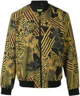 Versace hibiscus print bomber jacket - men - Polyamide/Polyester - 48