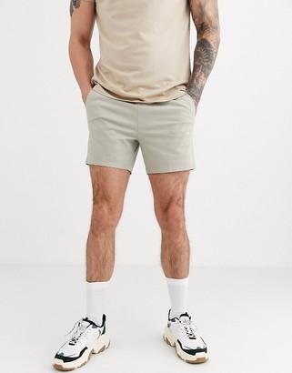 ASOS DESIGN slim chino shorter shorts with elastic waist in beige