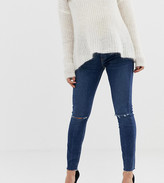 Asos DESIGN Maternity Ridley high waisted skinny jeans in dark wash blue with ripped knee detail with under the bump wai