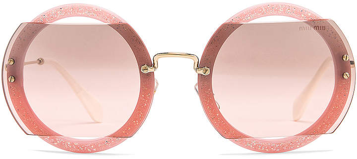 e9ff0c4b808f Miu Miu Pink Women's Sunglasses - ShopStyle