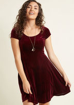 MDD1153 Layer it up or let it shine on its own - whatever your fashion mood, this burgundy velvet skater dress will spark a feel-good day! Designed with a scoop neckline, short sleeves, princess seams, and a subtle flair to its skirt, this ModCloth-exclusive mini