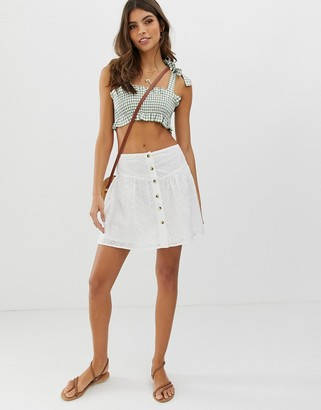 Asos Design DESIGN broderie mini skirt with button front-White