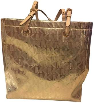 Michael Kors Gold Leather Handbags