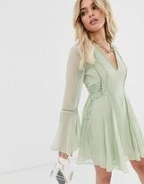 Asos Design DESIGN lace up mini dress with ladder trim