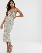 Asos Design DESIGN midi pencil dress with cut out and lattic embellishment