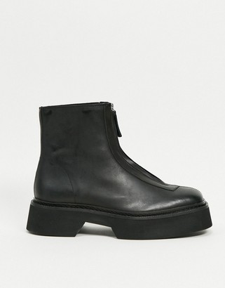 ASOS DESIGN chelsea boot in black leather with front zip detail on chunky sole