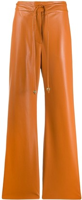 Nanushka Chimo vegan leather belted trousers