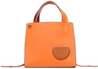 Danse Lente orange Margot outer pocket leather tote bag