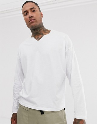 Asos Design DESIGN oversized long sleeve t-shirt with raw notch neck in white