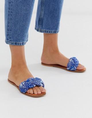 ASOS DESIGN Farlow plaited flat sandals in blue paisley print